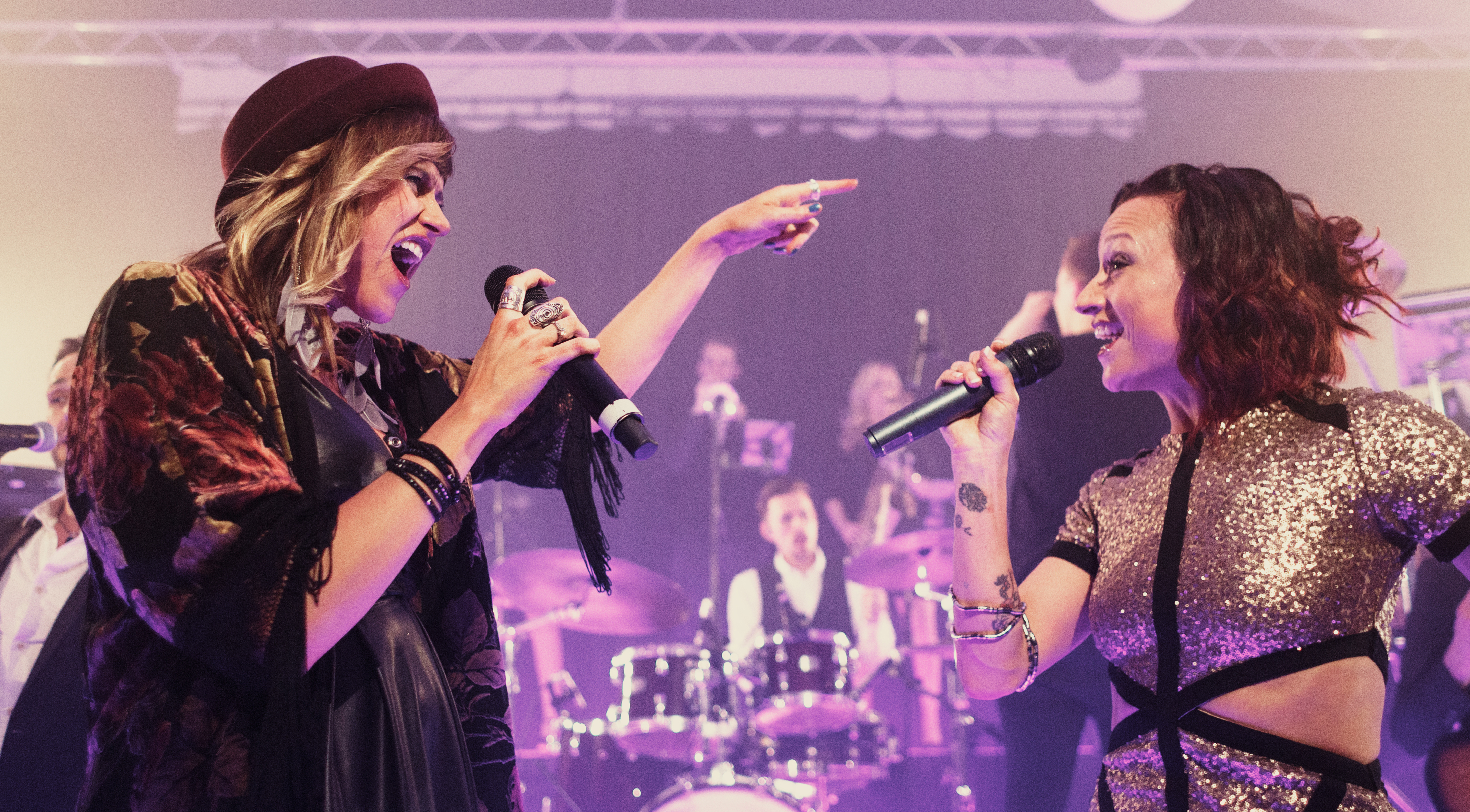Two female vocalists from The Talent performing duet.