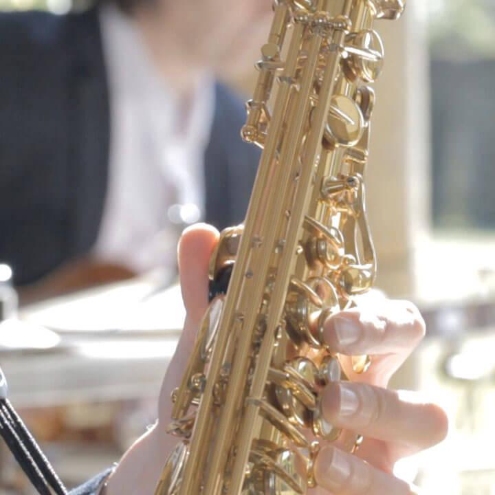 Closeup of saxophone.