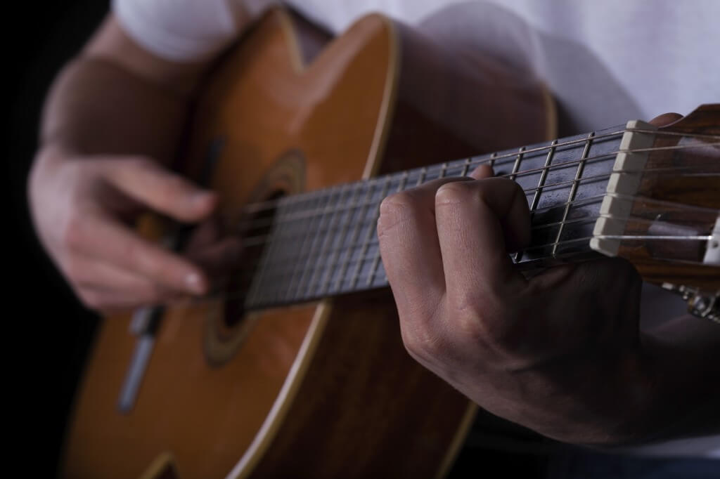 Man playing on guitar