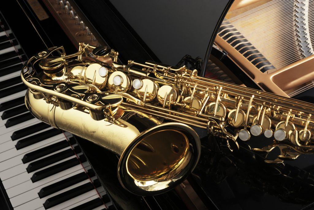 Alt saxophone on grand piano